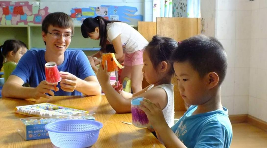 Projects Abroad volunteers working with children in China participate in an arts and crafts activity at a care centre.